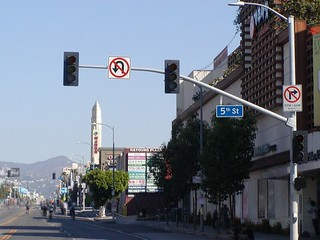 Northbound Western Avenue approaches, proceeds and crosses at Kaju California Supermarket Plaza Shopping Center Building Complex on 5th Street intersection traffic signal flashing red lights powered off followed by 4th Street and 3rd Street located at