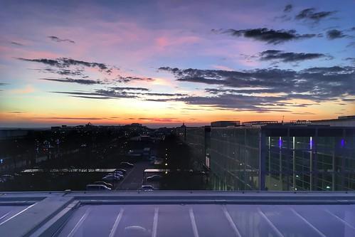 apple iphone se shopping centre multi storey car park sunset pink sky view miton keynes buckinghamshire clouds church