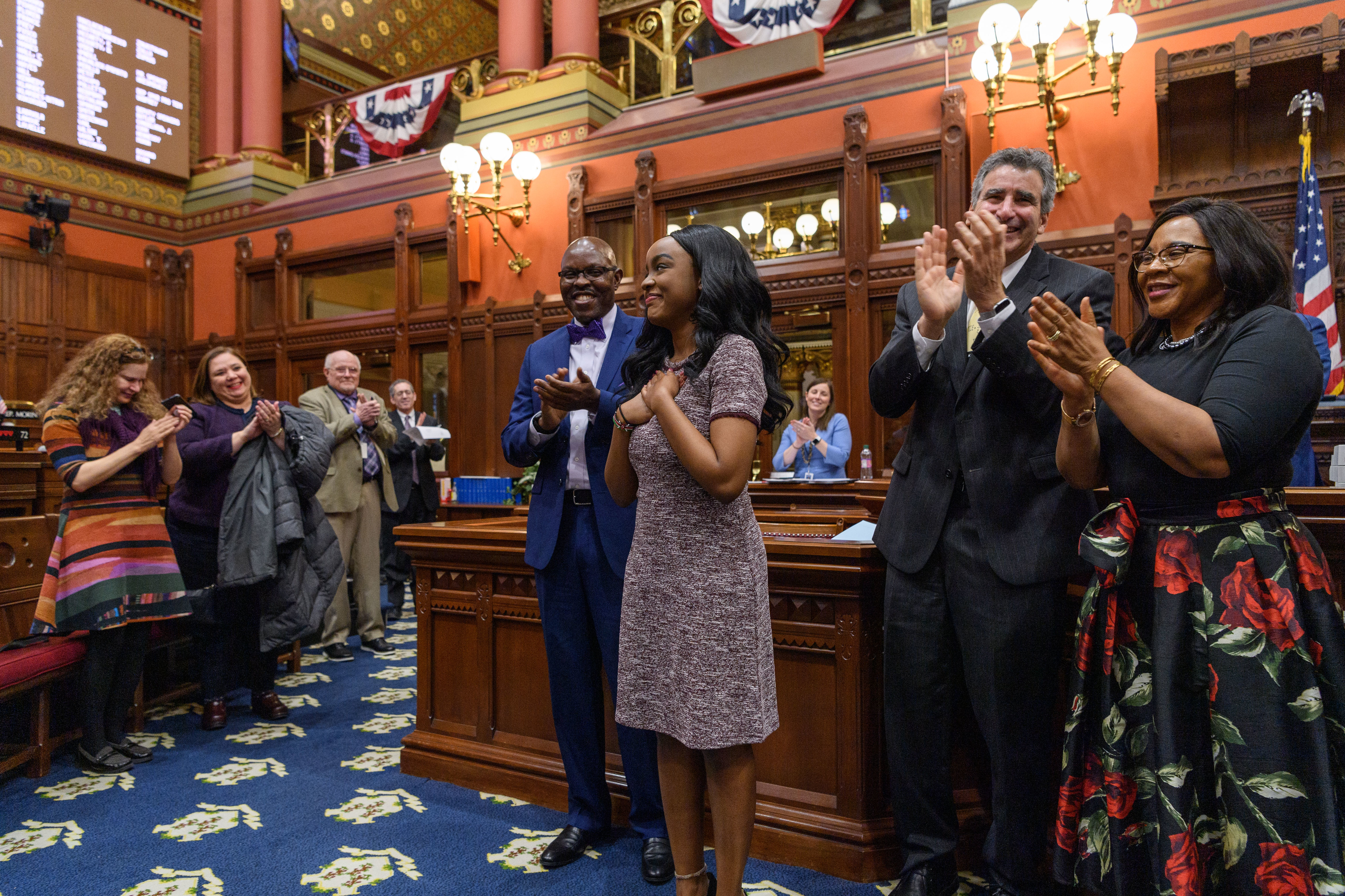 Rhodes scholar Wanjiku Gatheru '20 (CAHNR) receives applause from the State House of Representatives in Hartford on Dec. 18, 2019.