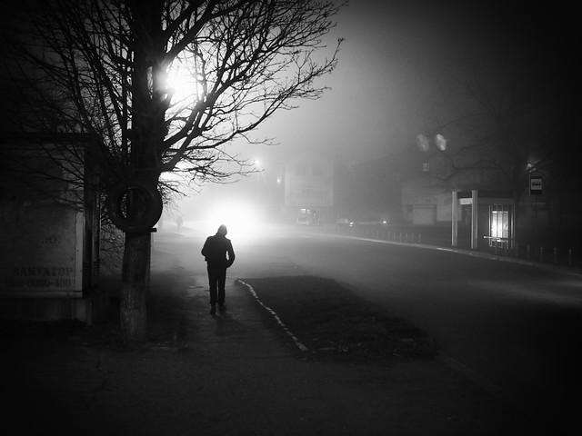 night road and man walking