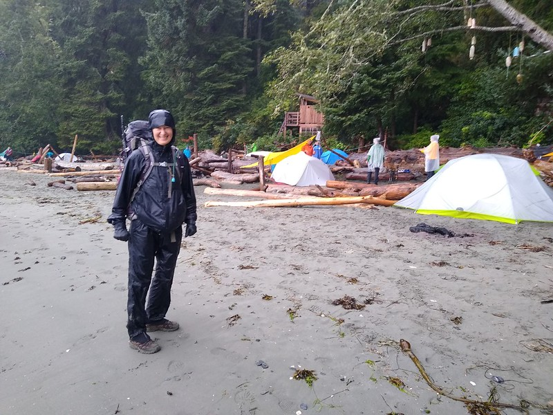 Vicki is happy and dry in her rainsuit as we begin our final day's hike out of Thrasher Cove in the rain