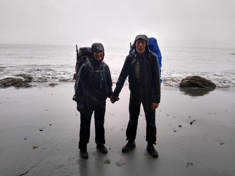 Vicki and I standing in the rain on the beach at the Thrasher Cove Campsite on the West Coast Trail