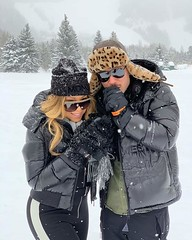 Mariah Carey in the snow with --- , did not give a name..  #mariahcarey, #wintersnow, #snow, #singer, #actress, #model, #evergreens, #plains, #photography, #background,