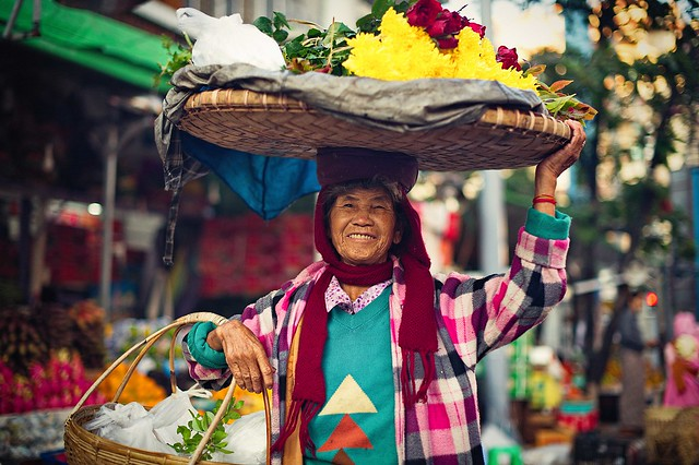 A portrait of local flower seller