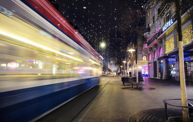 A tram zooms by on Bahnhofstrasse