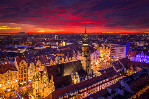 aerial architecture evening outdoor socialmedia street sunset winter wrocław lowersilesianvoivodeship poland no people travel destinations famous place urban skyline sky illuminated fire clouds beautiful amazing red fireclouds stunning bird eye view dusk building exterior cityscape city night sunrise