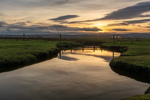 neston marshes sunset reflection