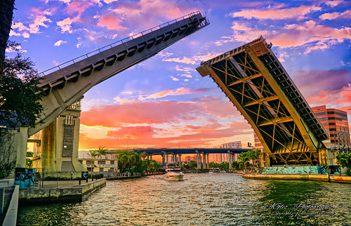 miamiriver downtownmiami bridge river perspective yacht sunset outdoors urbanexploration waterways riverwalktrail riverbank city clouds colors