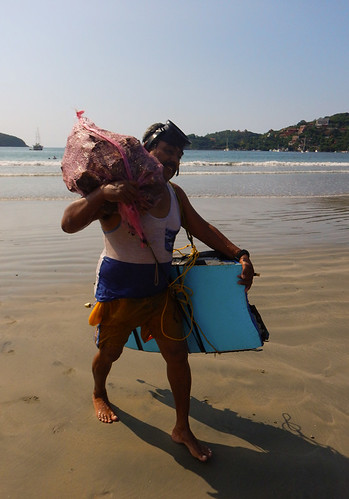 The oysterman with his catch in Zihuatanejo, Mexico