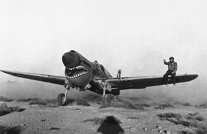 warhistoryonline: Kittyhawk Mark I fighter with the RAF 112 Squadron taxiing through the scrub of the Libyan desert, 2 April 1942. The crewman on the wing is helping guide the pilot whose view is obscured by the aircraft's raised nose. https://wrhstol.com