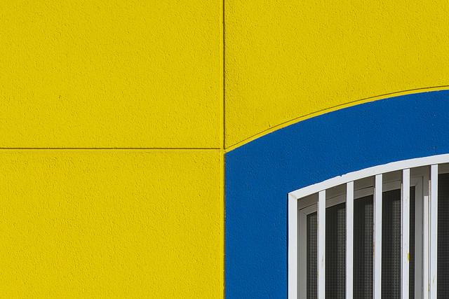 Yellow wall, blue window