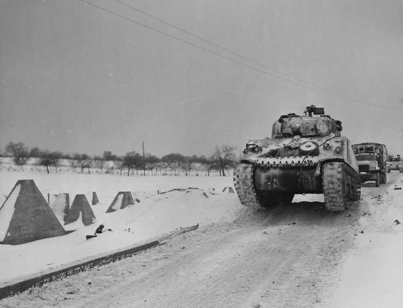 captain-price-official: M4 Sherman advancing along with a convoy near Bastogne during the Battle of the Bulge, December 1944/January 1945