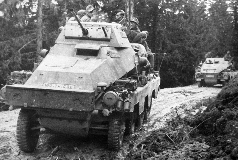 derpanzergraf: A Panzerpahwagen 231 followed by a heavier SdKfz 233