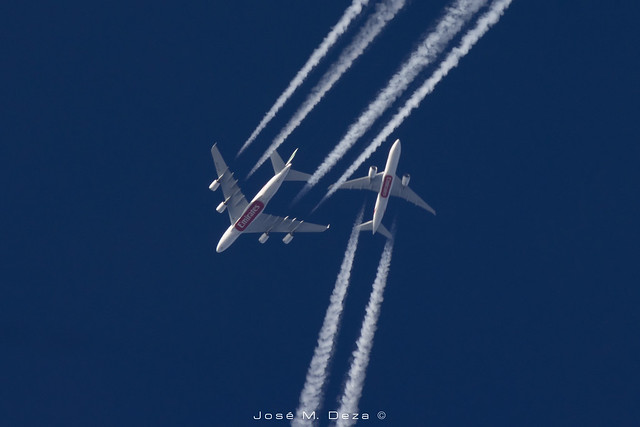 Two Emirates crossing over BCN