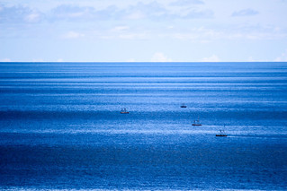 Simplicity. Boats on blue water.