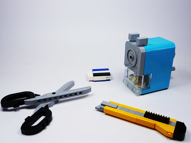 Some Stationery(Scissors, Eraser, Cutter Knife, and Pencil Sharpener)