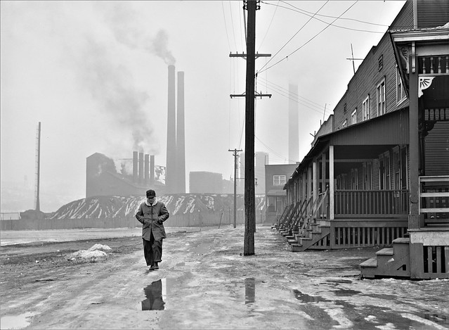 And Miles To Go: Scene in west Aliquippa, Pennsylvania. Stacks of the Jones and Laughlin Steel Corporation in background. January 1941.
