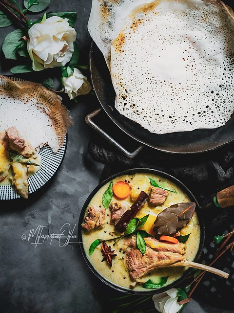 Fluffy at the core, crispy lacy exterior appams with kerala style lamb stew