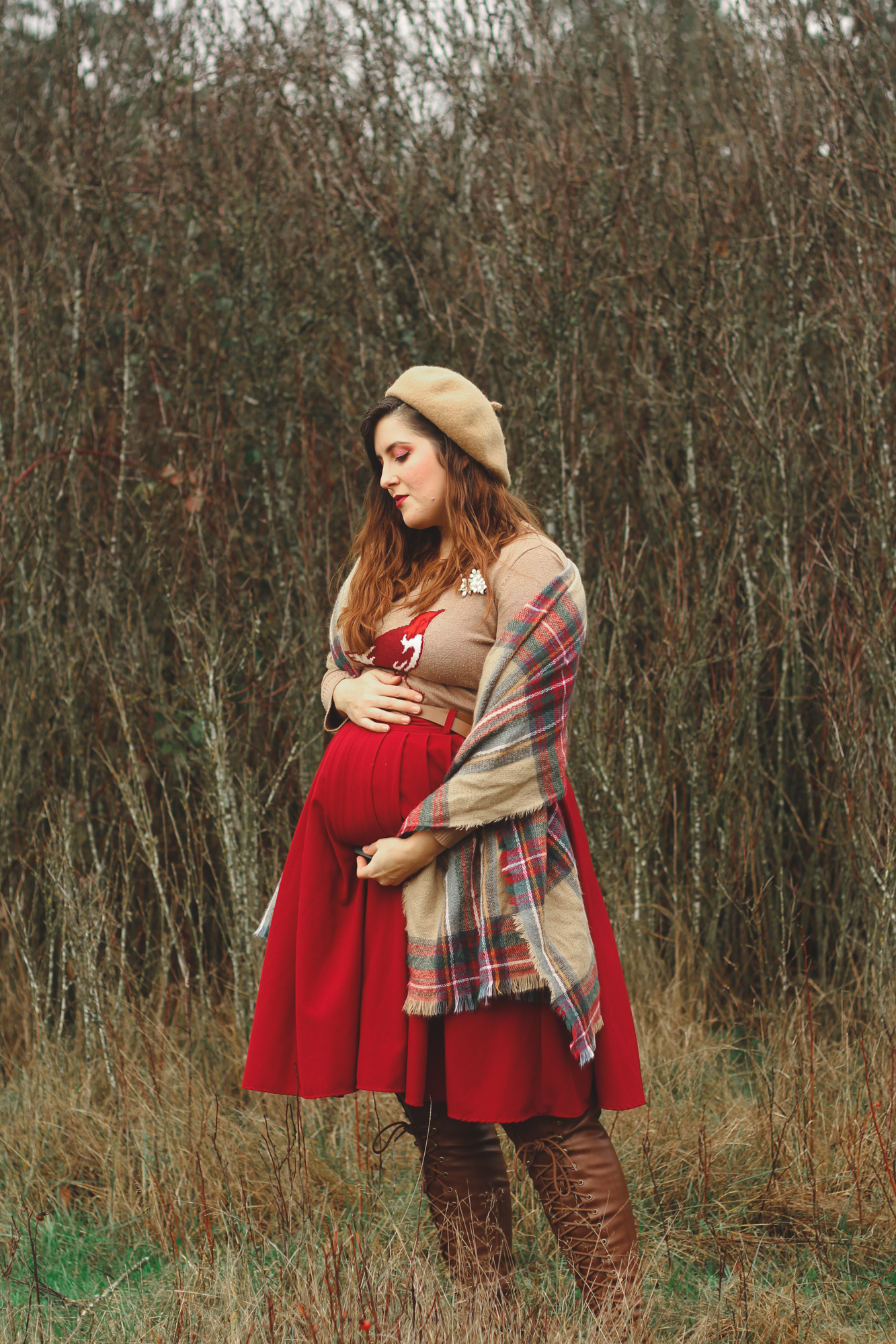 vintage-inspired maternity outfit of a bird sweater and maroon skirt
