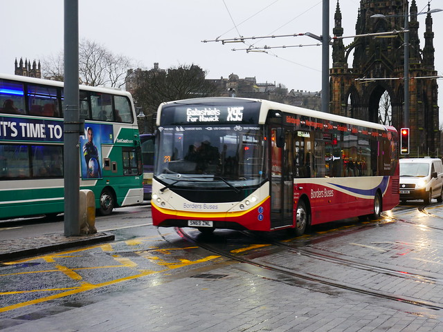 Border Buses AD E20D Alexander Dennis Enviro 200MMC SN69ZNL 11920 operating service X95 to Hawick at Princes Street, Edinburgh, on 7 January 2020.