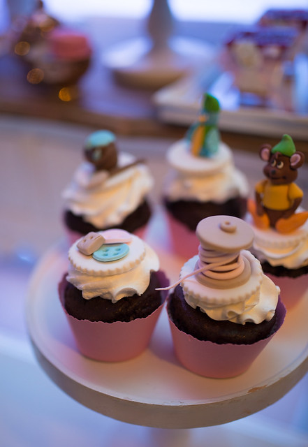 Closeup of cupcakes with cream and chocolate. Birthday party.