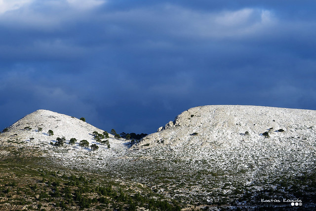 Snowy hillscape in cloudy day...