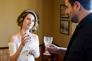 Bride and groom toast each other, Longmont, Colorado