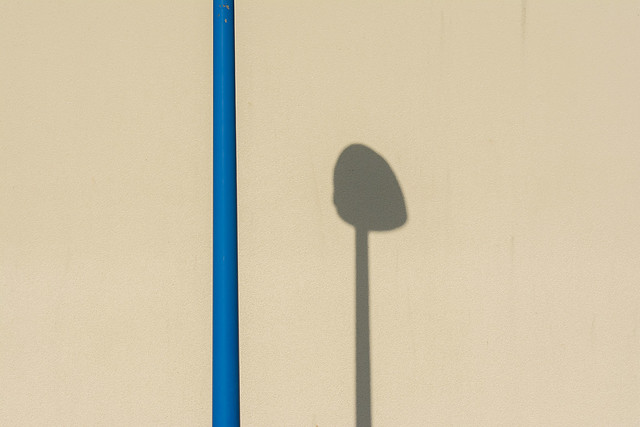 Blue pole and shadow
