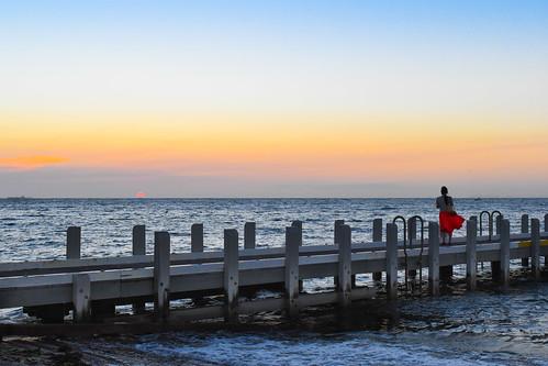 brightonbeach girl sunset pier dusk melbourne victoria australia sun waves