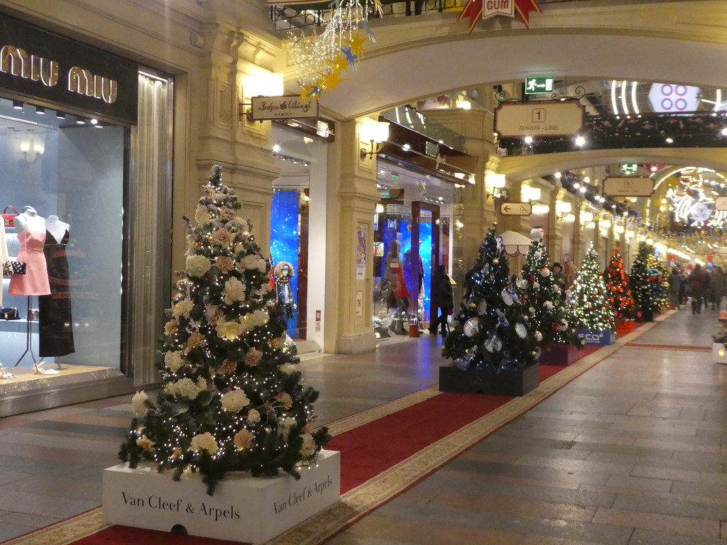 Christmas trees adorning the GUM department store Moscow