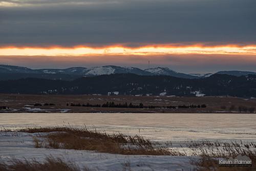 bearbutte bearbuttestatepark southdakota blackhills january winter nikond750 clouds ice icy frozen bearbuttelake sunset evening nikon180mmf28 telephoto orange gold golden sturgis