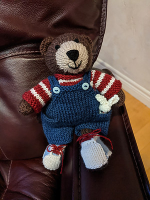 Another of Julie Williams little darlings is off Linda's needles - a Boy Bear wearing dungarees!