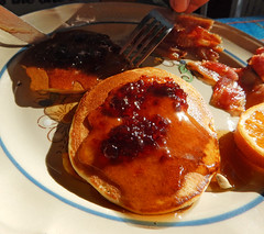 Pancakes, syrup and berry compote for a sun-lit breakfast in Zihuatanejo, Mexico