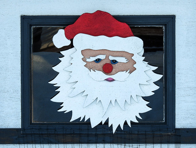 Santa on the side of a shed