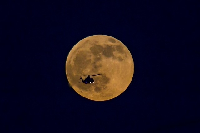 Helicopter Transiting the Rising Wolf Moon 10/01/20