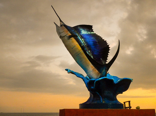 The sailfish statue at dusk in Puerto Escondido, Mexico