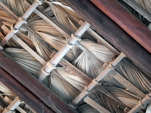 Woven palm leaf roof makes a pattern on the ceiling of a beach café in Puerto Escondido, Mexico