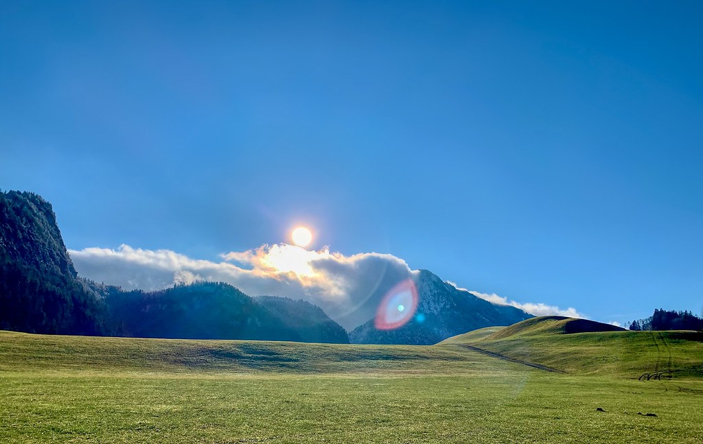 Sunlit landscape with mountains in the clouds near Thierberg, Tyrol, Austria