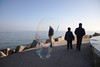 velenux posted a photo:Backstory: on January 1st, some crazy people in Pesaro take a bath at around noon in the chilly waters of the Adriatic Sea to salute the new year. There was a guy blowing huge bubbles just before the event and I managed to capture this candid portrait near the seaport.