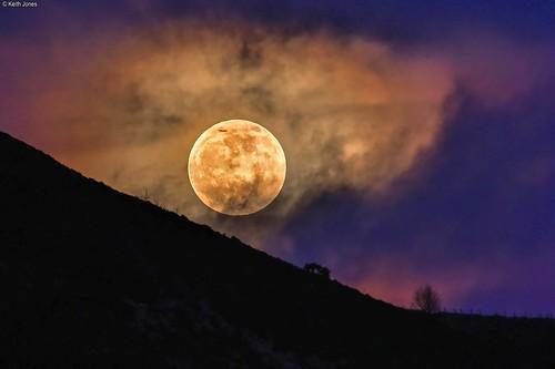 wolfmoon moon penumbraleclipse night sky clouds trealaw wales aeroplane mountain
