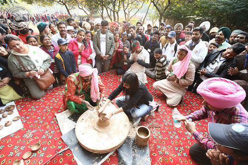 Renuka Ji participating in pot making