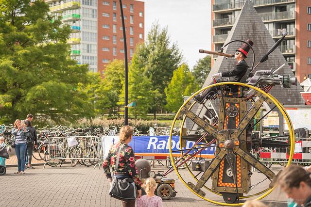 Rolling through Heerhugowaard on his high wheels.