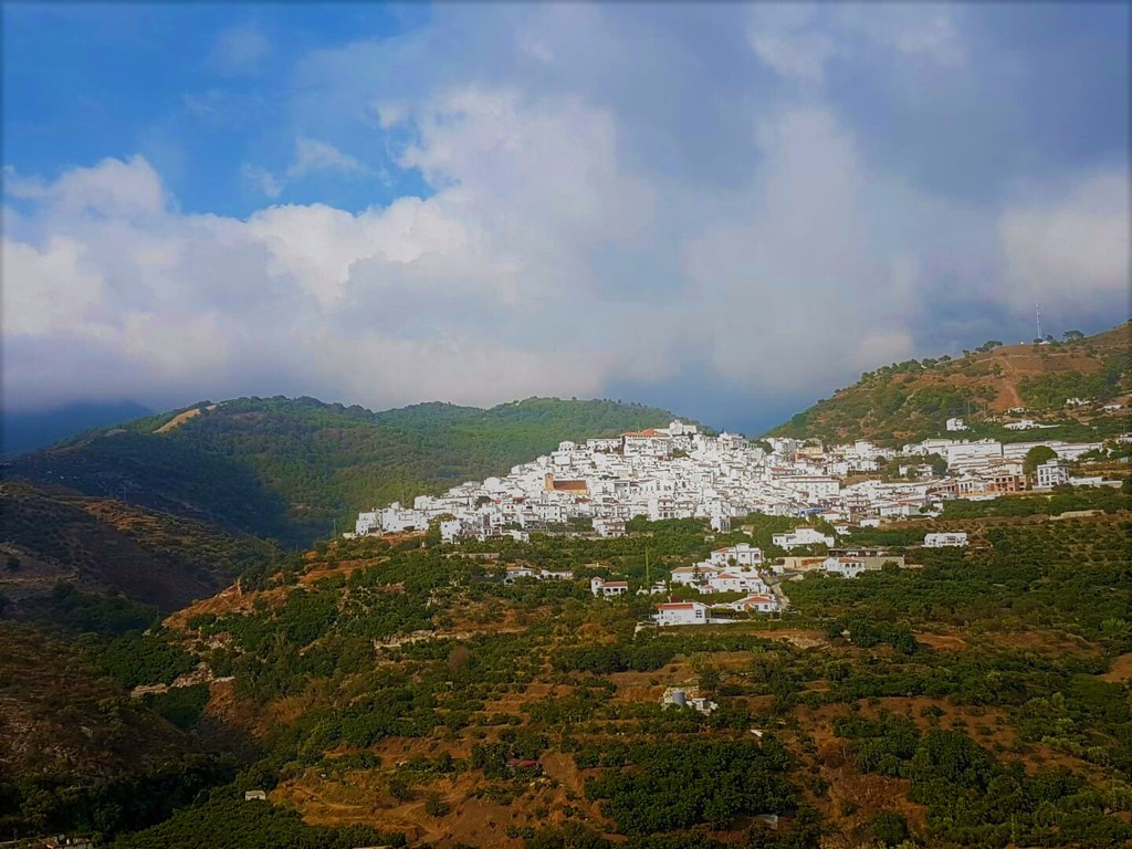 A white village spread on top of a hill