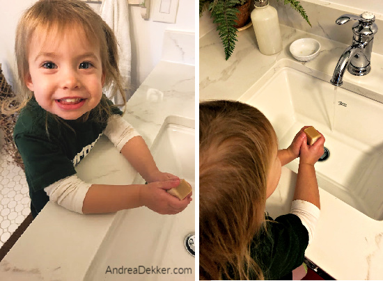 washing her hands with all-natural soap