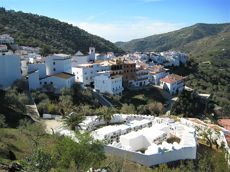 A white village nested among green hills