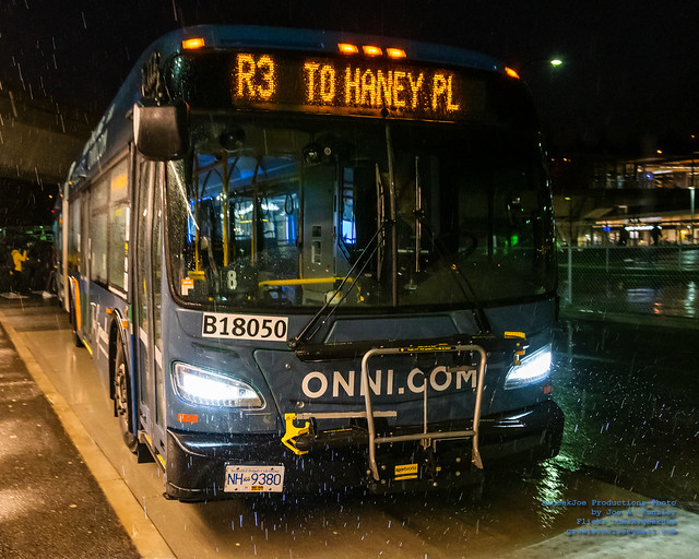 A RapidBus on R3 Pulls Up Thru the Rain at Coquitlam Central Station