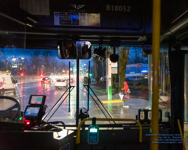 Riding In A RapidBus Pulling Up to A Stop in the PoCo Rain