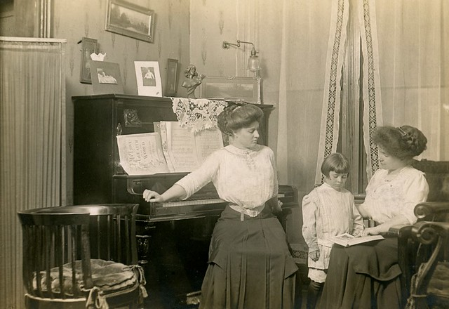 Posing at the Piano in the Parlor, ca. 1910