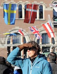 rokin sunday market visitor (under scandinavian flags)