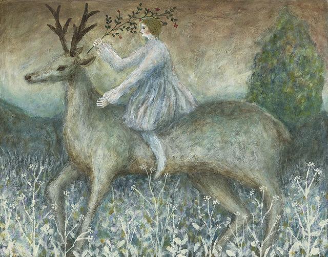 Girl straddling deer.